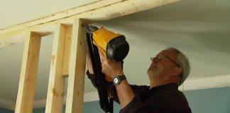 Danny Lipford using nail gun to framing up an interior wall.