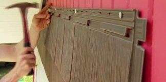 Attaching vinyl shake siding over wood siding on house.
