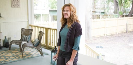 Phantom Screens CEO Esther De Wolde standing on the back porch of her historic home.
