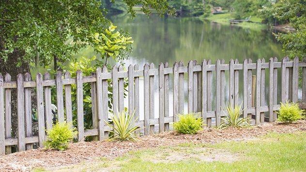 wood gate by lake