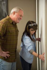 Homeowner Mary Leavins shows Danny how her closet doors don't close properly.