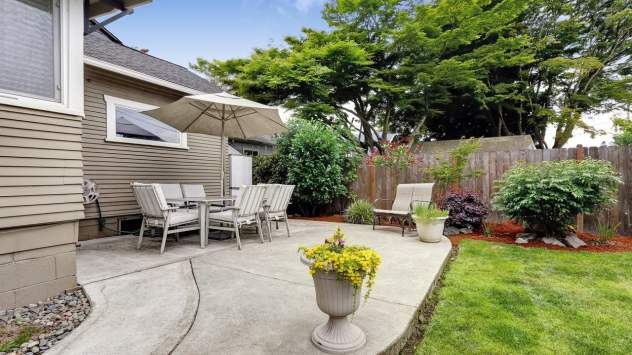 Backyard patio area and backyard landscape