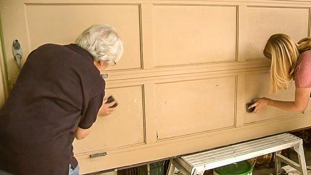 Sanding the garage door