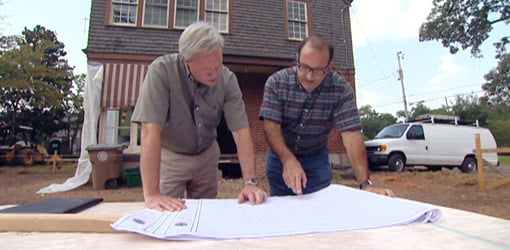 Danny Lipford goes over the plans for the Kuppersmith house with architect Pete J. Vallas.