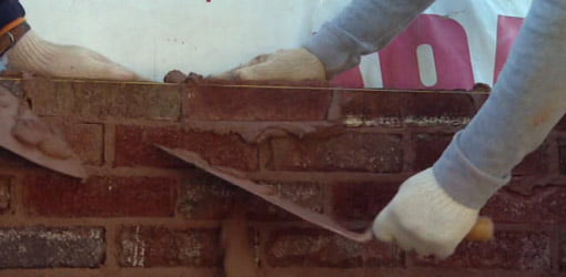 Laying brick on Kuppersmith Project house