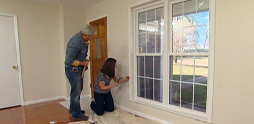 Adding wood  casing to a window.