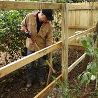 Danny Lipford working on fence.