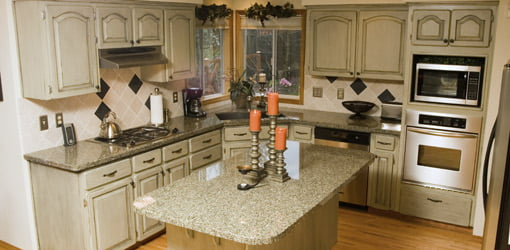 Kitchen with cabinets and granite countertops.