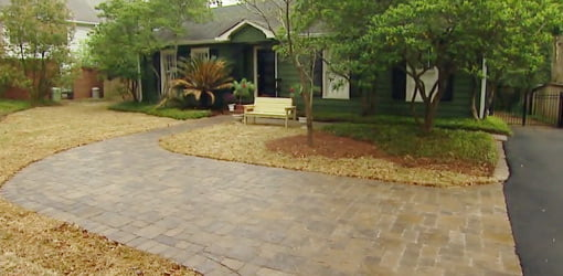 Completed paver driveway and front lawn.