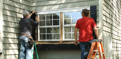 Danny Lipford and Allen Lyle replacing wood trim with cellular PVC.