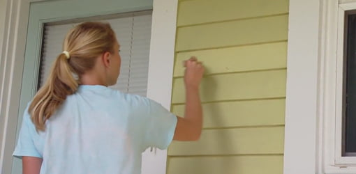 Painting the exterior siding on the house.
