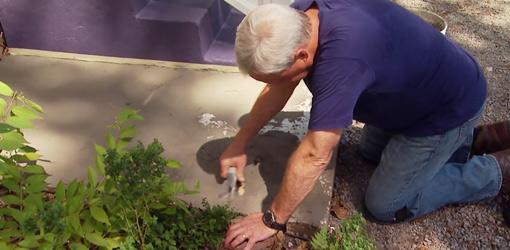 Danny Lipford resurfacing concrete slab.