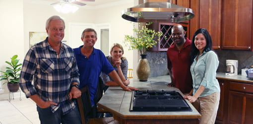 Today's Homeowner crew and contest winners in kitchen by island and new range hood.