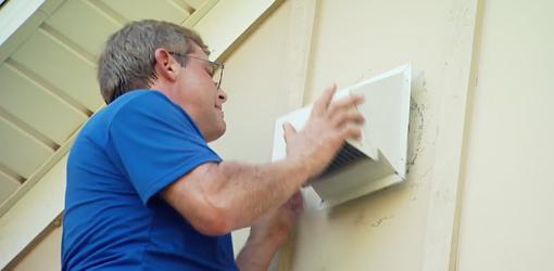 Allen Lyle venting the new bath fan through an outside wall.