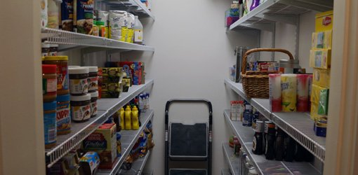 New stocked pantry with wire shelving.