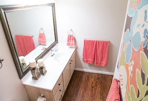 The completed bathroom with a MirrorMate frame.