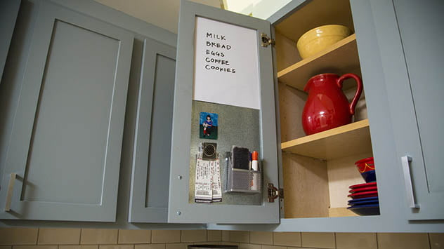 Use the inside of a kitchen cabinet door as a message board.