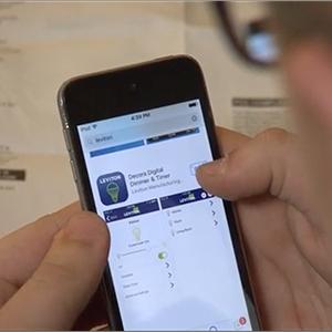 Kade controls the fan using the Leviton app.