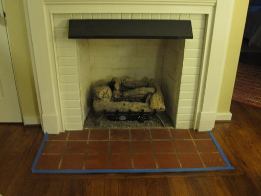 Painter's tape around fireplace hearth.