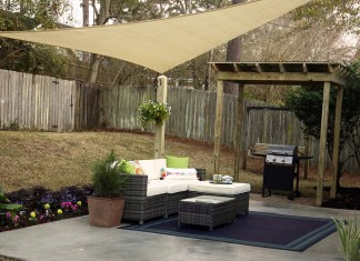 Upgraded patio with new furniture, shade sail, new flowers and resurfaced concrete