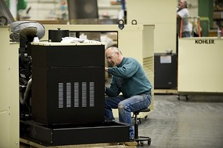 Tom Lefeber manufactures a generator at Kohler Co.