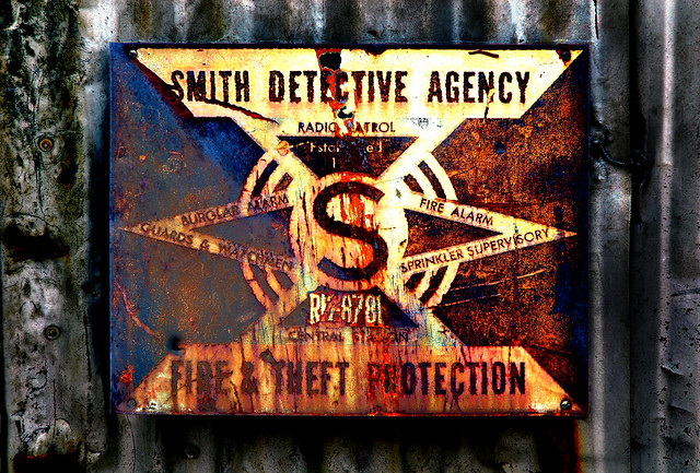 Rusty detective agent sign