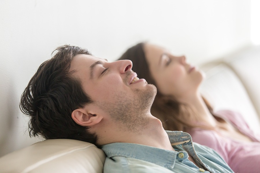 Couple showing how to eliminate stress with relaxation