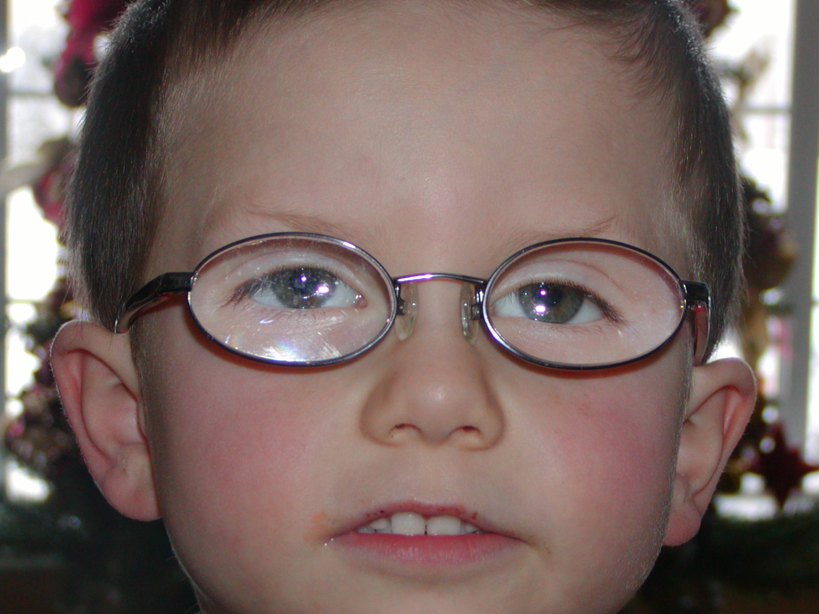 picture of a farsighted boy with glasses - prescription +9 and +10