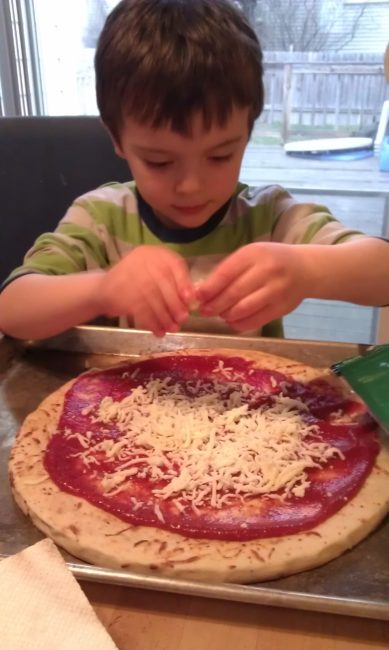 Cooper making pizza - Toddling Around Chicagoland