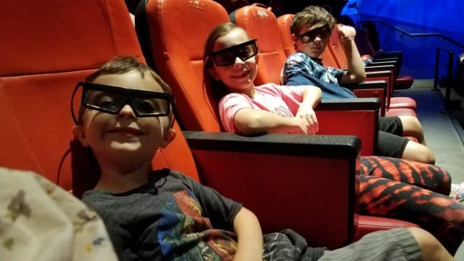 Boys wearing 3D glasses in theater