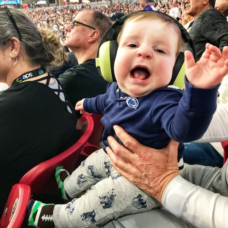 Ear Protection for a Baby at a Football Game Attending a Sporting Event with a Child Under 2 Toddling Traveler