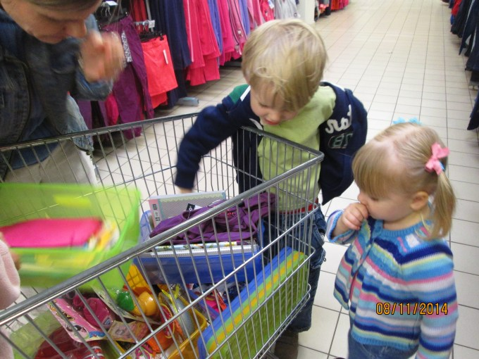 Filling the shopping cart. Long morning--Ariela's getting ready for a  nap.