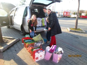 Groceries loaded in the van, packing up individual gift bags in the grocery store parking lot