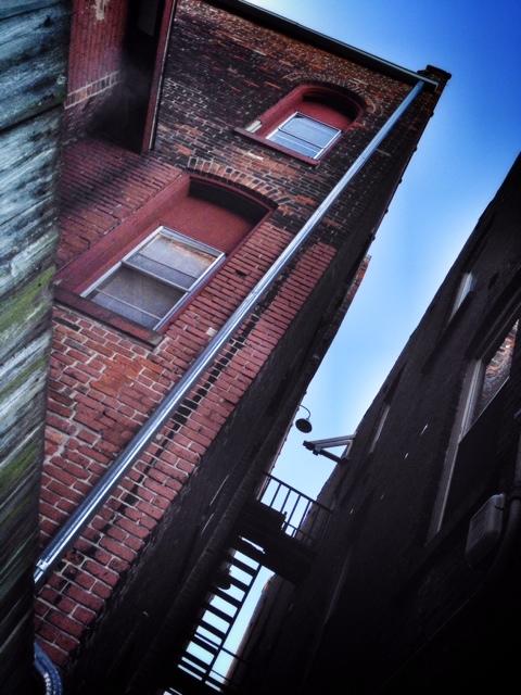 Blue Sky. Dark Alley