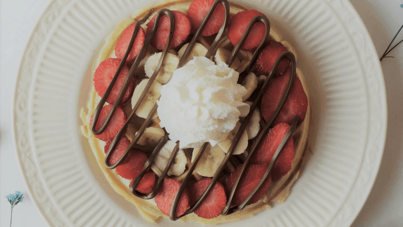 Strawberry Banana Nutella Waffles that should be at every breakfast and brunch! Try this classic vanilla waffle recipe!