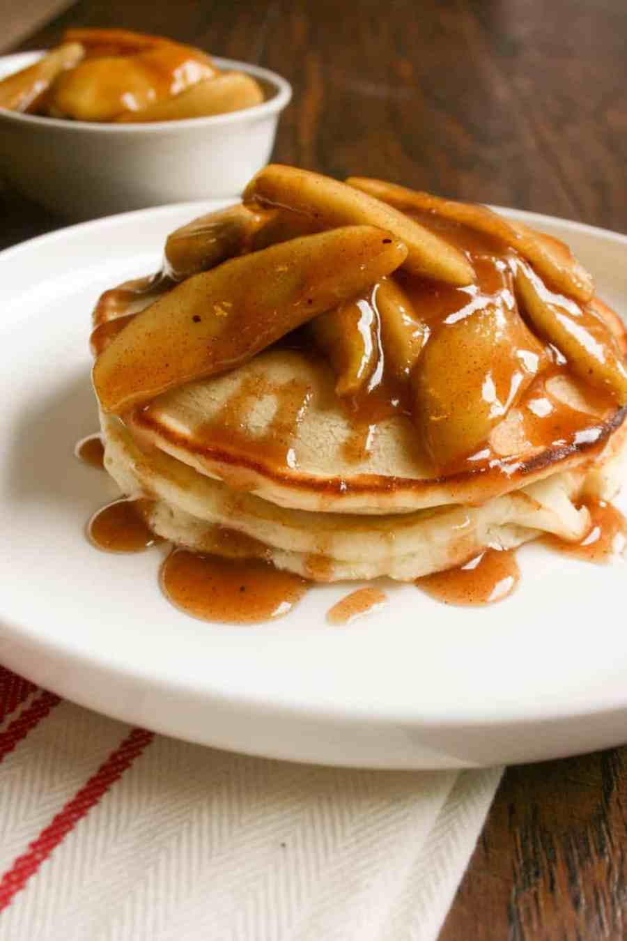 Pancakes with autumn apple topping is the perfect breakfast for fall! Sweet, light an airy, no need for syrup on these!