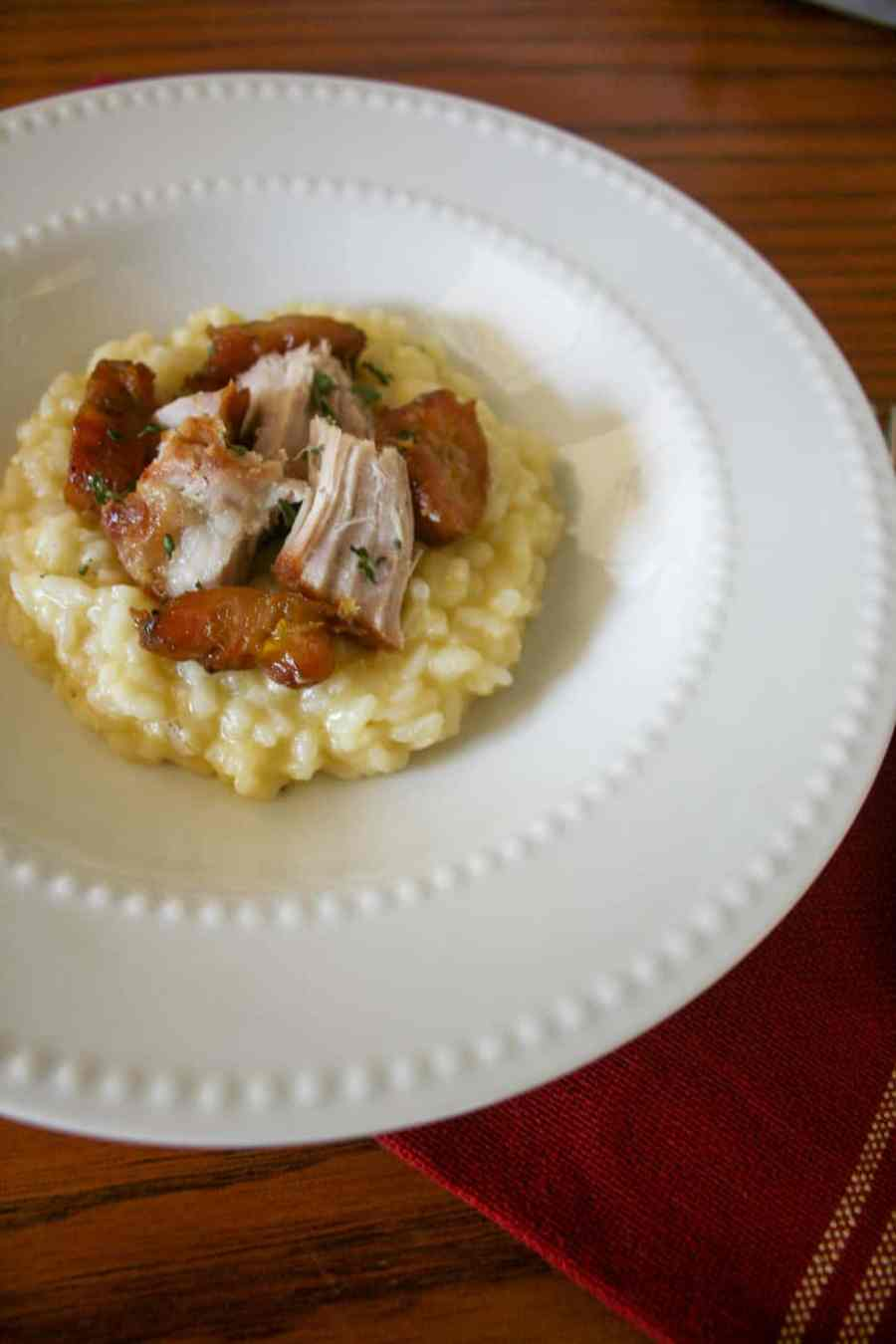 Parmesan Garlic Risotto topped with pork chunks and sweet plantains is the perfect dinner with a Hispanic twist!
