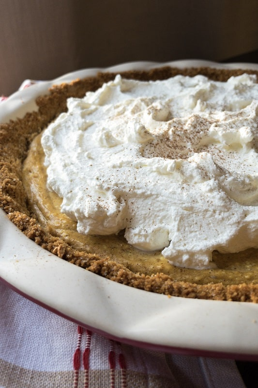 Three delicious layers in this pie: graham cracker crust, cheesecake and pumpkin pie. The perfect Thanksgiving and holiday themed dessert!