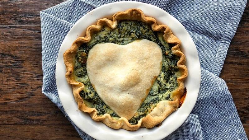 A savory pie filled with cheesy Ricotta and Parmesan and loads of green leafy veggies. A perfect holiday appetizer, whether Thanksgiving or Christmas!