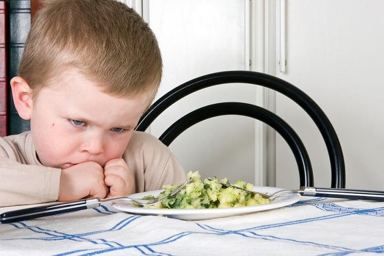 adversity - boy refusing to eat vegetables