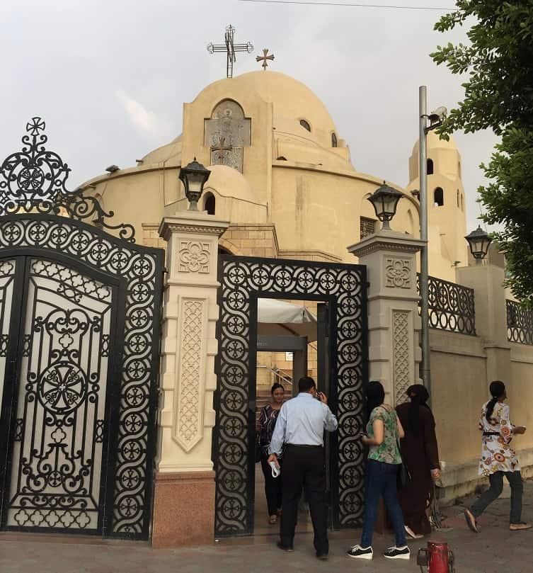 Egyptian Christian walk through a metal detector to go into church