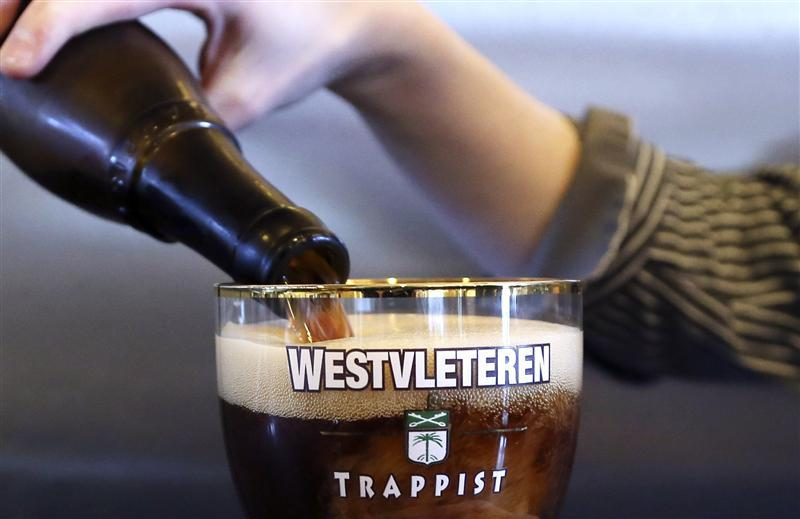 Employee pours a Westvleteren Trappist beer at the brewery in Westvleteren