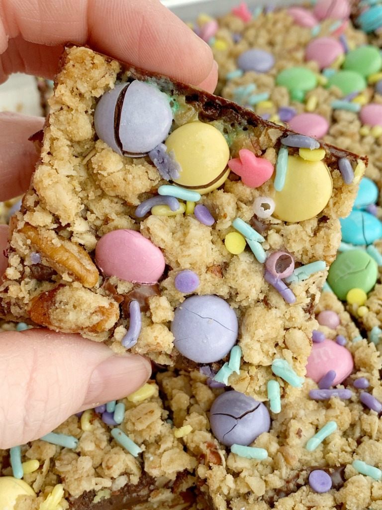 Easter Goody Bars   Goody Bars   Easter Recipe   Easter Goody Bars are the perfect springtime treat! A pecan and oat crumble mixture for the crust, filled with a creamy fudge filling, topped with more crumble and Easter m&m candy and sprinkles. #easter #easterrecipes #dessert #dessertrecipes #recipeoftheday #holidayrecipes