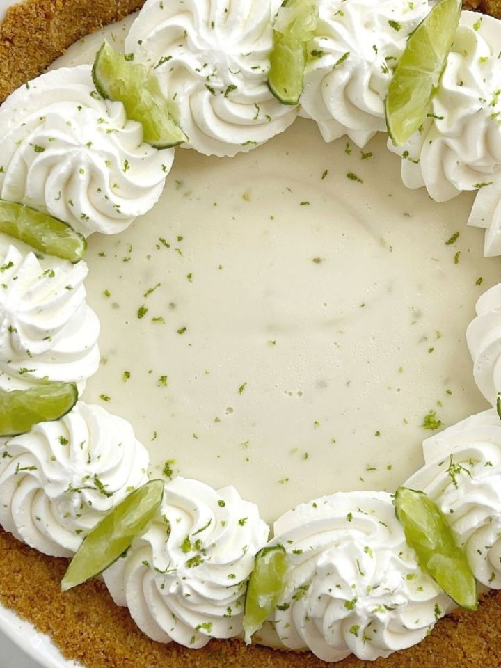 Overhead picture of key lime pie inside a 9-inch pie plate.