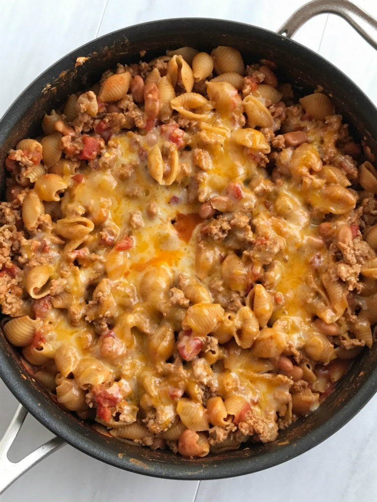 Skillet turkey taco pasta is a one pot meal made in a skillet pan on the stove. Cheesy, flavorful turkey with tender pasta, beans, tomatoes, and seasonings. If you need dinner in 30 minutes then this it!