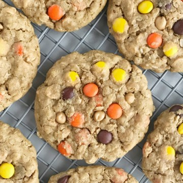 Triple Peanut Butter Monster Cookies   These triple peanut butter monster cookies are a peanut butter lovers dream! Thick, chewy, soft monster cookies loaded with peanut butter, oats, peanut butter chips, and reeses pieces. These are insanely delicious & addicting. A tall glass of cold milk is a must have   Together as Family #peanutbuttercookies #cookierecipes #dessertrecipes #monstercookies #monstercookierecipes
