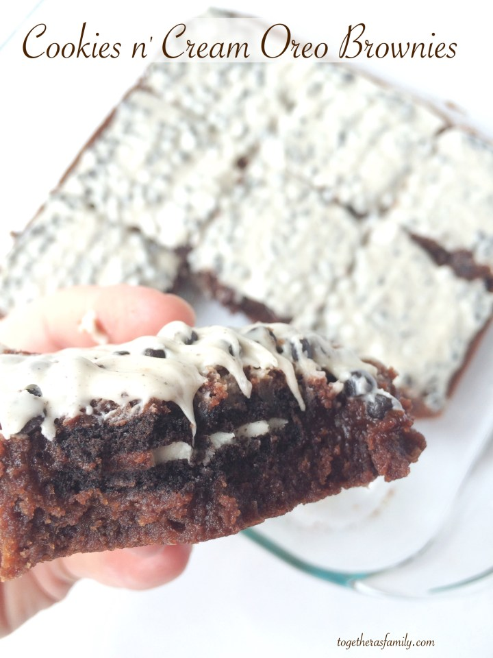 """COOKIES N"""" CREAM BROWNIES- brownies stuffed with Oreo cookies and a CANDY BAR frosting! www.togetherasfamily.com"""
