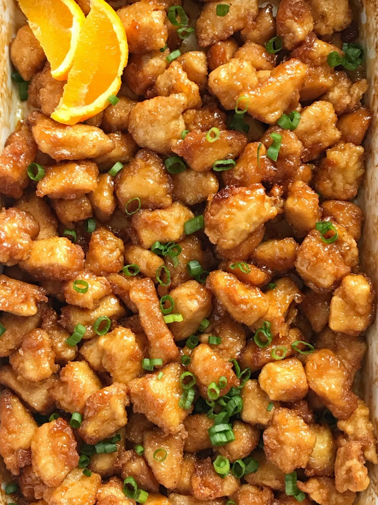 Baked Crispy Orange Chicken | Chinease Food | Dinner Recipe | Orange Chicken | Baked Orange Chicken | This baked orange chicken is tastes better than any Chinese take-out you'll get at a restaurant. Crispy coating of egg & cornstarch and then it's baked in a sweet and delicious orange sauce. This is a dish that you will want to make over and over. #dinnerrecipes #easydinnerrecipes #orangechicken #chicken #dinner #chineasefood