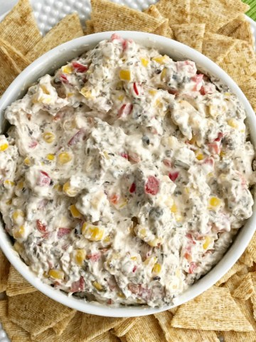 Vegetable ranch cracker dip is filled with corn, olives, red pepper, cream cheese, andranch seasoning mix! So creamy, easy to make, and packed with flavor. Great for a bbq, party, or appetizer.