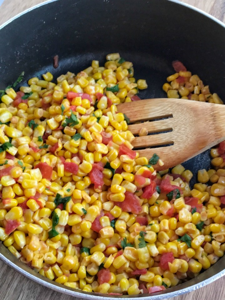 Crisp sweet corn, chopped tomato, cilantro, and lime come together to create the best side dish. Southwestern corn is an easy and healthier side dish to serve alongside Mexican food or for any dinner. Only takes minutes to prepare and it's so yummy!